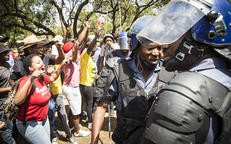 FILE: Police negotiated with University of the Free State students to disperse after they vandalised a statue of apartheid era leader CR Swart. Picture: Reinart Toerien/EWN.