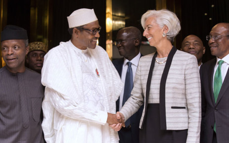 his handout photo released by the International Monetary Fund shows International Monetary Fund Managing Director Christine Lagarde (R) shaking hands with Nigerian President Muhammadu Buhari (L).