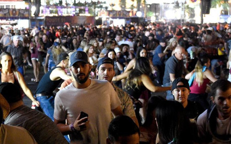 People flee the Route 91 Harvest country music festival grounds after a active shooter was reported on October 1, 2017 in Las Vegas, Nevada.  Picture: AFP