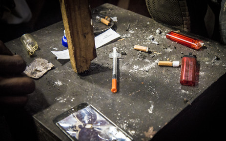 FILE: A table inside a heroin den holds spent lighters, a used needle, old cigarette ends and piece of foil used for chasing the drug in Woodstock, Cape Town. Picture: Thomas Holder/EWN