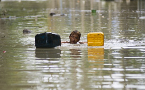 At least 103 people have been killed and more than a million critically affected by the flooding. Picture: AFP.