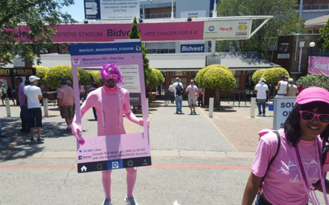 People dressed in pink shirts, caps and even costumes, making their way to the ground. Picture: Morena Mothupi/EWN