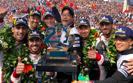 FILE: Fernando Alonso (second left) celebrates on the podium with his Toyota teammates after winning the 24 Hours of Le Mans on 17 June 2018. Picture: @alo_oficial/Twitter