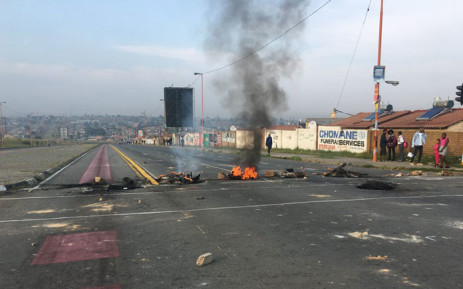 Burning debris obstructs a road during protest action in Pennyville, Soweto on 12 April 2019. Picture: Kgomotso Modise/EWN