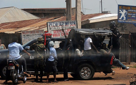 Police and Military escort people out of Kaduna, Nigeria, on June 19, 2012. Picture: AFP.