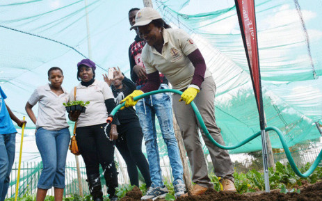 Public Protector Busisiwe Mkhwebane works in the garden of the Moepathutse orphanage on Mandela Day. Picture: Twitter/@PublicProtector