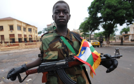 A young Seleka coalition rebel poses near the presidential palace in Bangui in Central African Republic. Picture: AFP.