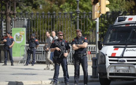 Members of the Catalan police Mossos d'Esquadra secure the area outside the Parc de la Ciutadella (Citadel Park) which houses the Catalan regional parliament in Barcelona on 10 October 2017 ahead of an address by Catalonia's leader. Picture: AFP.
