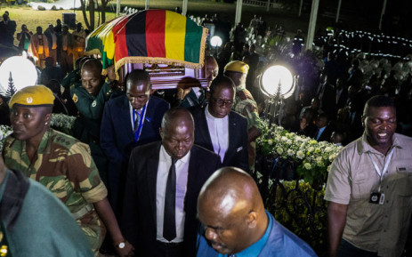 Pallbearers carry the casket of late former Zimbabwean President Robert Mugabe as it arrives at his former Blue Roof residence in Harare on 11 September 2019. Picture: AFP