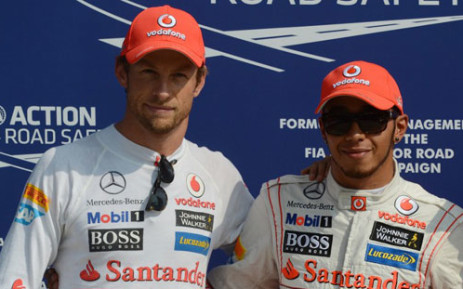 McLaren Mercedes' British driver Jenson Button (L) and McLaren Mercedes' British driver Lewis Hamilton pose in the parc ferme at the Autodromo Nazionale circuit IN Monza, Italy, on September 8, 2012. Picture: AFP.