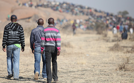 FILE: Lonmin mineworkers gathered on a hill on the outskirts of Wonderkop village in the North West in August 2012. Picture: EWN.