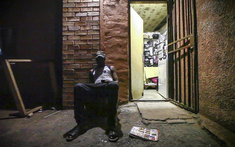 A Malawian refugee sits and listens to music after dinner at a sanctuary in Mayfair. Picture: Thomas Holder/EWN