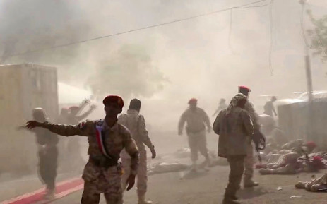 FILE: This AFPTV screengrab from a video made on 1 August 2019, shows Yemeni security forces rushing at the scene of a missile attack on a military camp west of Yemen's government-held second city Aden. Picture: AFP