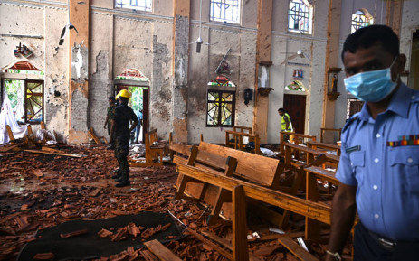 FILE: Security personnel inspect the interior of St Sebastian's Church in Negombo on 22 April 2019, a day after the church was hit in series of bomb blasts targeting churches and luxury hotels in Sri Lanka. Picture: AFP.