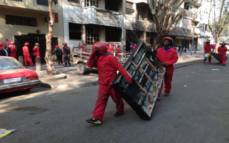 FILE: About 500 Red Ants conducted an eviction of Wellington House in Hillbrow, a flat notorious for being drug den and a criminal hotspot. Picture:Vumani Mkhize/EWN.