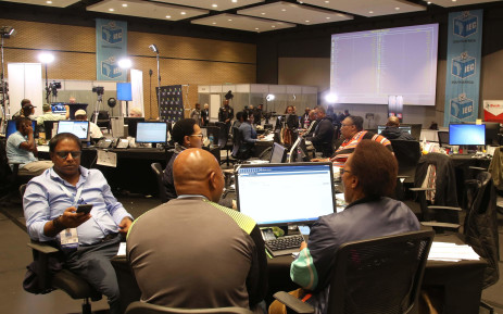 IEC Officials work through data at the IEC Centre in Cape Town. Picture: Bertram Malgas