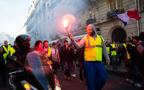 FILE: Protesters demonstrate on the Faugbourg Saint-Honore street in Paris on 17 November 2018, during a nationwide popular initiated day of protest called 'yellow vest' (Gilets Jaunes in French) movement to protest against high fuel prices which has mushroomed into a widespread protest against stagnant spending power under French President. Picture: AFP