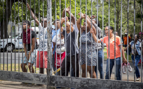 Stellenbosch University students protest at the gates of the local police station after a confrontation with Saps resulted in some being taken into custody on 17 November 2015. Picture: Aletta Harrison/EWN.