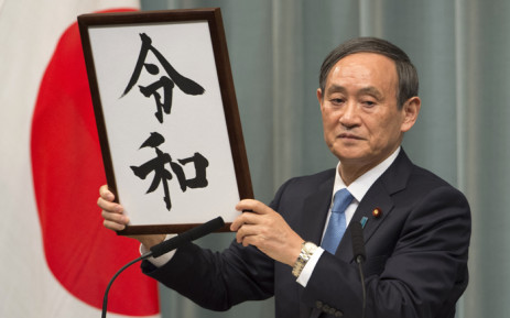 Japan's Chief Cabinet Secretary Yoshihide Suga announces the new era name 'Reiwa' during a press conference at the prime minister's office in Tokyo on 1 April 2019. Japan announced its new imperial era, which will begin next month when Emperor Akihito abdicates, will be known as 'Reiwa', a word that includes the character for 'harmony'. Picture: AFP