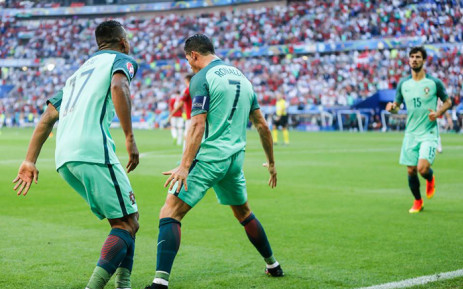 Portugal's captain Cristiano Ronaldo and Luis Nani celebrate after the team played to a 3-3 draw but still managed to progress to the Euro 2016 last 16 on 22 June 2016. Picture: Facebook.