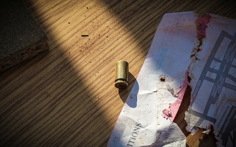 Scenes of last night's struggle. A shell casing from a pistol lies among looted furniture outside the Fair Price furniture shop in Soshanguve. Picture: Thomas Holder/EWN
