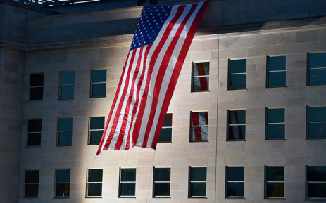 A US flag is flown at sunrise at the Pentagon crash site near the National 9/11 Pentagon Memorial on September 11, 2015 - the 14th anniversary of the 9/11 attacks. Picture: AFP.