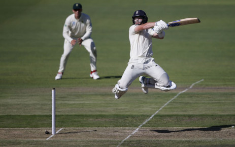 England's Ollie Pope (R) jumps in the air after playing a shot during the first day of the third Test cricket match between South Africa and England at the St George's Park Cricket Ground in Port Elizabeth on 16 January 2020. Picture: AFP
