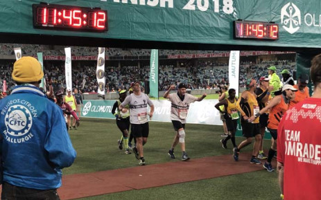 Runners cross the finish line 15 minutes before 2018 Comrades Marathon cut-off time. Picture: @ComradesRace/Twitter.