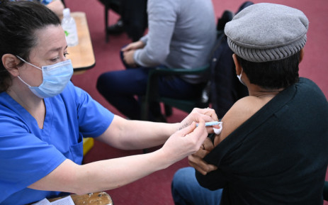A health worker administers a dose of the AstraZeneca/Oxford vaccine at a coronavirus vaccination centre at the Fazl Mosque in southwest London on March 23, 2021, on the first anniversary of the first national COVID-19 lockdown. Picture: Daniel Leal-Olivas/AFP