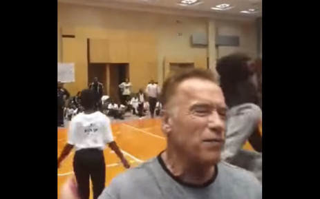 A screenshot of a fan kicking Arnold Schwarzenegger in the back at the Arnold Classic Africa Festival in Sandton. Picture: World's Strongest Fan/Youtube