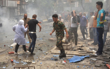 Syrian security forces evacuate medical staff after rockets reportedly fired by rebels hit Al-Dabbeet hospital the in government-controlled neighbourhood of Muhafaza in the northern city of Aleppo on 3 May, 2016. Picture: AFP.
