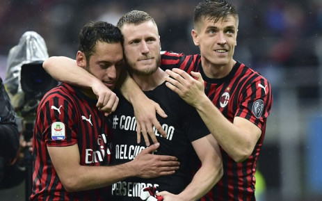 AC Milan's Turkish midfielder Hakan Calhanoglu (L) and AC Milan's Polish forward Krzysztof Piatek (R) walk with AC Milan's Italian defender Ignazio Abate (C) after Abate played his last match with the club at the end of the Italian Serie A football match AC Milan vs Frosinone on 19 May 2019 at the San Siro stadium in Milan. Picture: AFP