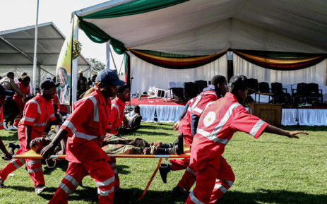 Injured people are evacuated after an explosion at the stadium in Bulawayo where Zimbabwe President just addressed a rally on 23 June 2018.  Picture: AFP.