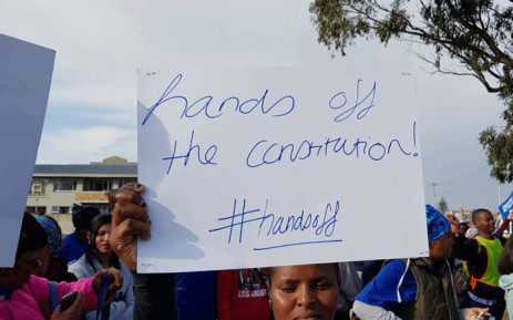 A Democratic Alliance supporter holds up a poster during land hearings in Cape Town, on 4 August 2018. Picture: @Our_DA/Twitter