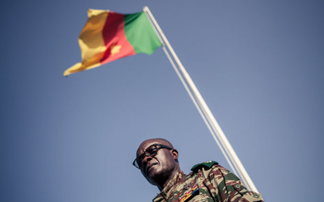 FILE: Cameroonian general Donatien Nouma Melingui, in charge of military operations in the South-West Region of Cameroon stands by a national flag at the 21st Motorised Infantry Brigade headquarter on 26 April 2018 in Buea. Picture: AFP