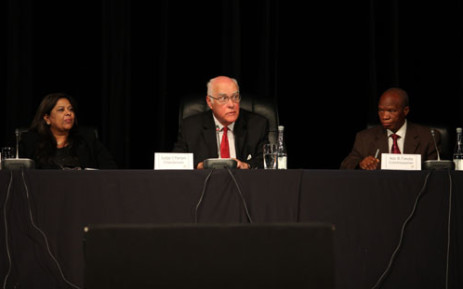 Retired Judge Ian Farlam and commissioners at the Farlam Commission of Inquiry into the Marikana shooting on 3 October 2012. Picture: Taurai Maduna.