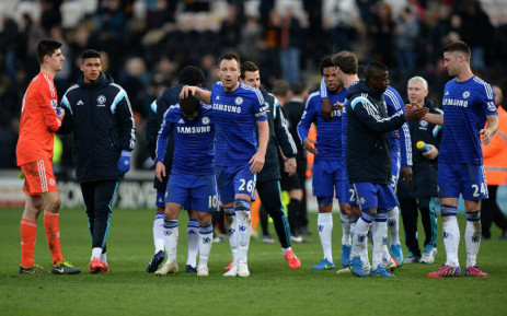 Chelsea players celebrate their victory on the pitch after the English Premier League football match between Hull City and Chelsea at the KC Stadium in Kingston upon Hull, north east England on 22 March, 2015. Picture: AFP