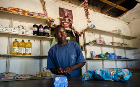 Solomon Chakauya, waits for customers in his grocery store, in Chinamhora district north-east of Zimbabwe's capital Harare on 10 December 2018. Picture: AFP