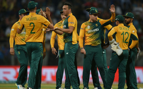 South Africa's Kyle Abbott (C) is congratulated by teammates after taking the wicket of England's Alex Hales during the World T20 cricket tournament match between England and South Africa at The Wankhede Stadium in Mumbai on March 18, 2016. Picture: AFP.