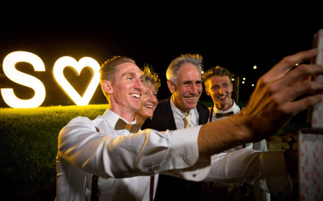 Australian Commonwealth Games sprinter Craig Burns (L) and fiance Luke Sullivan (R) pose for a photograph with Rob (C) and Robyn Burns (2L) ahead of their marriage ceremony at Summergrove Estate, New South Wales on 8 January 2018. Picture: AFP.