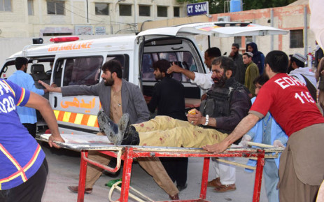 Pakistani volunteers carry an injured policeman to a hospital following a suicide bombing attack, in Quetta on 24 April 2018. Picture: AFP