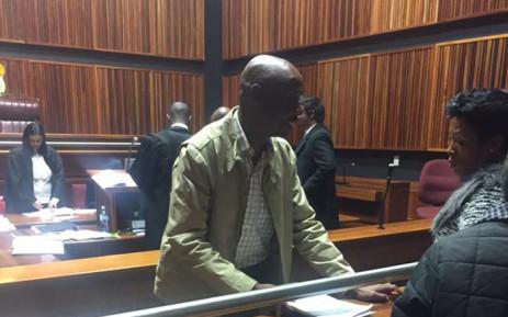 FILE: Donald Sebolai talks to a relative inside the Palm Ridge Magistrates Court. Picture: Thando Kubheka/EWN.