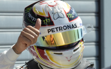 Pole position winner Mercedes AMG Petronas F1 Team's British driver Lewis Hamilton celebrates after the qualifying session at the Autodromo Nazionale circuit in Monza on 5 September 2015 ahead of the Italian Formula One Grand Prix. Picture: AFP