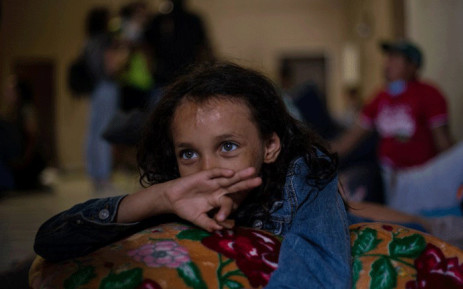 "Honduran Ashley, 8, rests at the Hotel Migrante shelter in Mexicali, Mexico, on 24 April, 2018, after arriving with other Central American migrants taking part in the ""Migrant Via Crucis"" caravan. Picture: AFP."