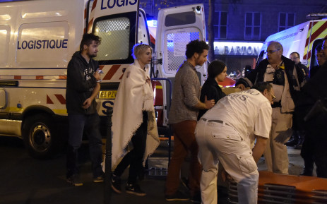 "Rescue workers evacuate injured people near the Bataclan concert hall in central Paris, on November 13, 2015. At least 39 people were killed in an ""unprecedented"" series of bombings and shootings across Paris and at the Stade de France stadium on November 13.  Picture: AFP"