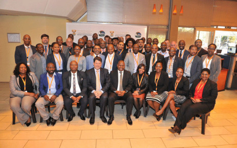 Minister Zweli Mkhize, Deputy Minister Andries Nel and Municipal Infrastructure Support Agent CEO Ntandazo Vimba with some of the recently appointed engineers and town planners deployed to distressed and dysfunctional municipalities. Picture: @NationalCoGTA/Twitter.