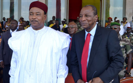 President Alpha Conde of Guinea (R) and his Niger counterpart Mahamadou Issoufou (L) look on during a welcoming ceremony in Conakry on June 9, 2012 after their meeting. Picture: AFP.