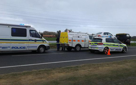 FILE: Police officials and forensic experts leave the scene where a police officer was attacked and stabbed to death while on his way to work on the N2 on 29 July 2015. Picture: SAPS.