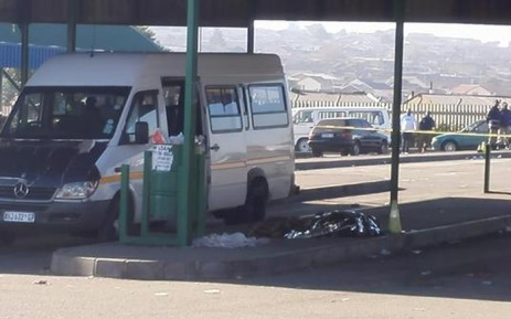 The body of the woman shot dead at the Sangweni taxi rank, witnesses say she was shot in the bus during early morning shootout. Picture: Govan Whittles/EWN.
