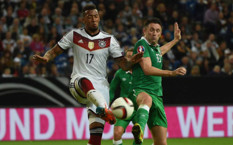 Germany's Jerome Boateng and Ireland's Robbie Keane fight for the ball during the Euro 2016 qualifiers on 14 October 2014. Picture: DFB-Team official Facebook page.
